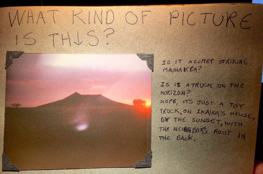 """""""What kind of picture is this? Is it a comet striking Mauna Kea? Is it a truck on the horizon? Nope, it's just a toy truck, on Ikaika's [dog] house, by the sunset, with the neighbor's roof in the back."""""""