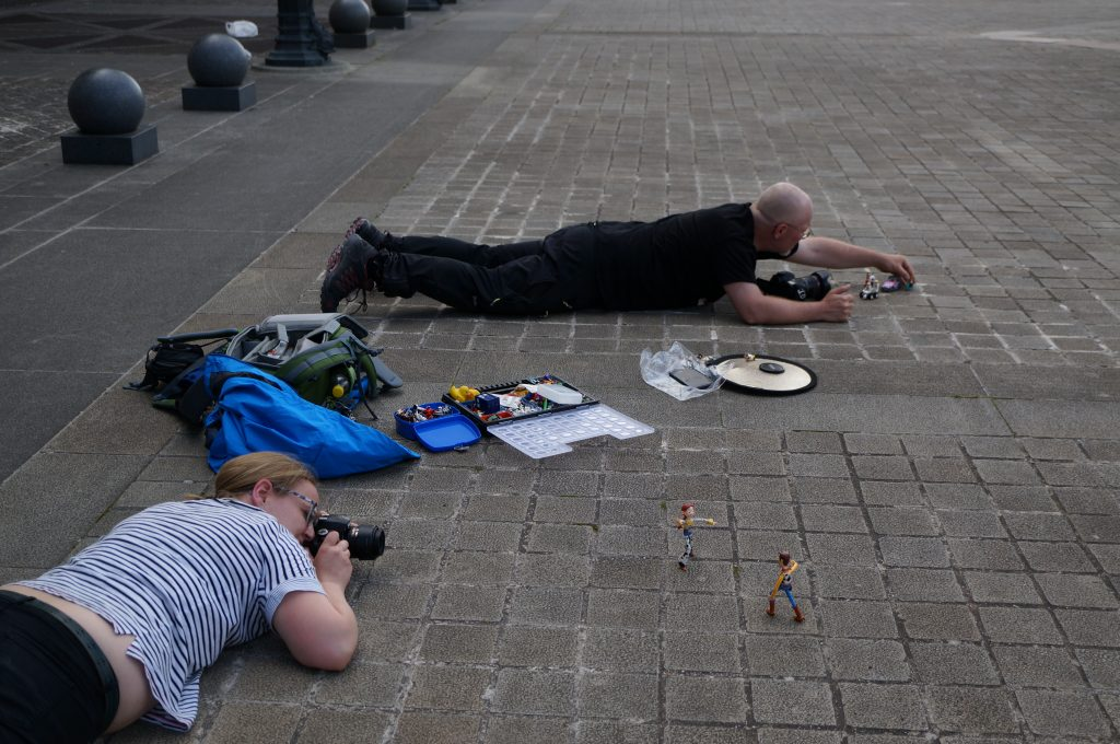 Toy photographers not taking a nap